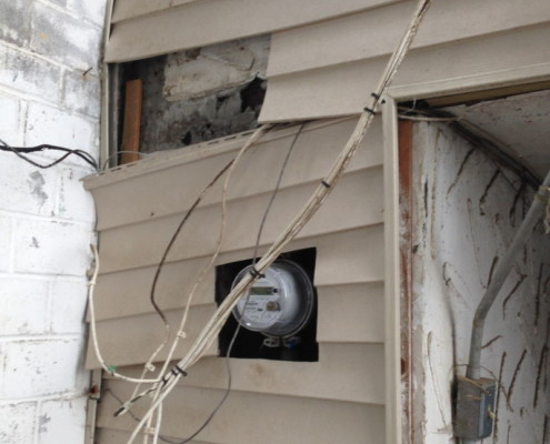 Loose siding led to water damage inside and unsafe wiring conditions